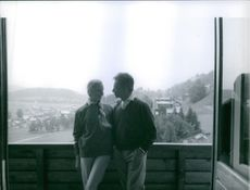Couple Eliette and Herbert von Karajan pictured together on a high ground.