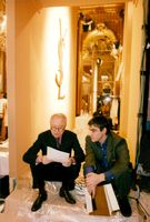Pierre Bergé, co-founder of Yves Saint Laurent, goes through the agenda.