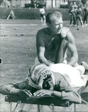 Man giving massage to a young athlete.  Taken - Oct. 1964