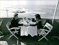 Prince Michel and Béatrice Marie Pasquier having a drink on a ship.