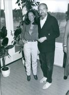 Swedish TV producer, director and writer Torbjörn Axelman with a woman.