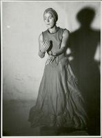 Ingeborg Carlsson standing while performing in the stage, 1939.