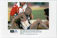Mike Powel after injuring his leg in the jump during the Olympic Games in Atlanta in 1996