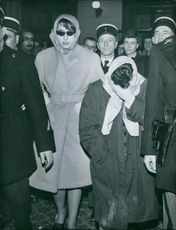 Police escorting people in the station.  1966 Kumar married to each other Brou OCI Eight