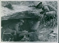 Colonial troops writing underground during wartime.