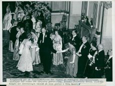 King Gustaf VI Adolf and Queen Louise Mountbatten greet their guests in the White Sea