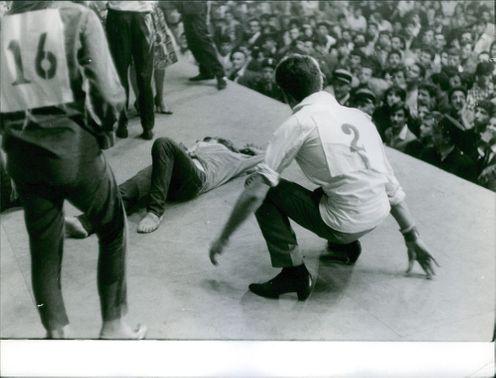 A man fainted on stage while the crowd looks on during a Rock and Roll concert.  - Jun 1961