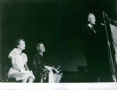 Barry Goldwater giving a speech whilst Hattie and Margaret are listening on the background