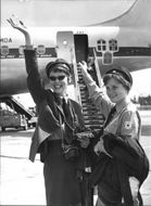 Two Red Cross representatives on their way to Kenya posing in front of their aircraft.