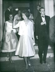 Queen Sofia and Juan Carlos walking while smiling.