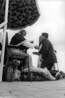 Pope Paul VI shaking hand with man.