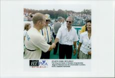 The king and the queen congratulate Magnus Petersson for the silver medal in archery