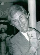 Russ Abbot pointing his finger to the camera. 1984.