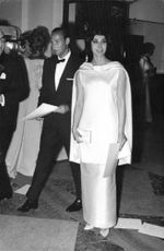 Karim Aga Khan with Patricia Deblave arriving at an event