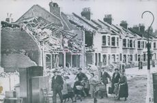 Residents of east London, who had her home destroyed by bombs, leaving the ravaged district to seek a quieter getaway. 1940.