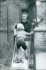 Princess Alexia of Greece and Denmark playing in the slide.