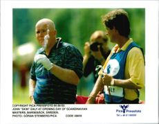 Golf player John Daly with his caddy on the first day of Scandinavian Open 1995