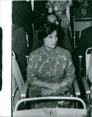 Robert Hossein wife sitting and looking at something.
