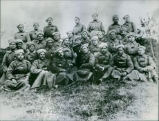 Rodion Yakovlevich Malinovsky with other troops striking a pose for a photograph.