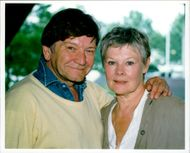 Michael Williams and Judi Dench in an unknown context.