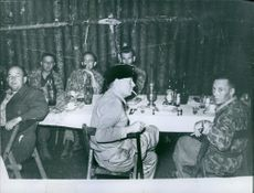 Soldiers having drink and smoking.