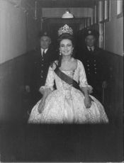 Jeanne Moreau smiling, dressed as Catherine the Great.