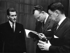 Docenterna Nils Elvander and Gunnar Helen going through his papers, television symposiekommitténs chairman. file. BCs. Carl Tham