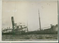 The SS Norge ship sinking in the sea during wartime, 1915.