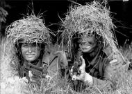Female soldiers in camouflage