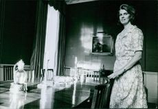 Princess Margaretha standing by the dining table.