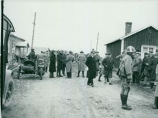 Villagers, soldiers and rescue workers during a field manoeuvre.