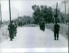 An armed military men walking on the street, Cyprus.