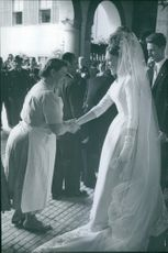 1960 - Carl, Duke of Württemberg and Diane, Duchess of Württemberg (née Princess Diane Françoise Maria da Gloria of Orléans) greets people on their wedding day.