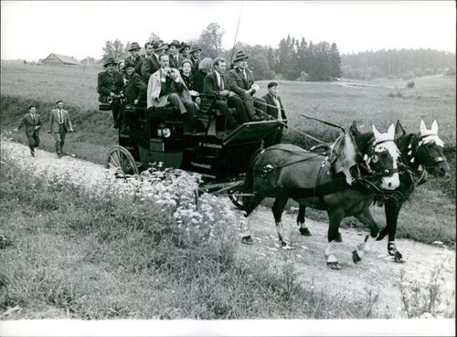 People riding on a horse cart.