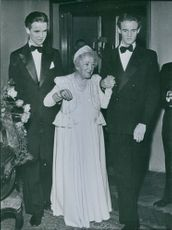 Gabriel and Jacob Branting assisting Anna Branting to walk during her 90th Birthday party. 1979.