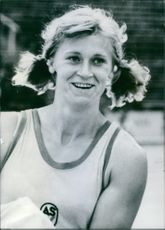 Burglinde Pollak wearing a jersey and smiling.