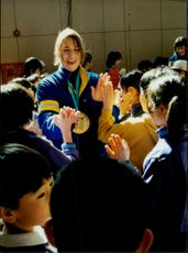 The Swedish Women's Hockey team's team captain takes good care of the children after a visit to the Kawadaskolan during the Winter Olympics 1998