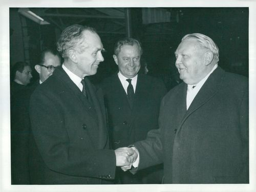 Britain's Prime Minister Sir Alec Douglas-Home is greeting Dr. Ludwig Erhard welcome to London
