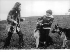 Claudia Cardinale and son Patrizio playing with dogs.