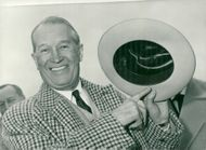Maurice Chevalier in Paris with cowboy hat from Hollywood