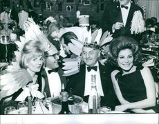 Darryl Zanuck with three other people at an event, 1963.