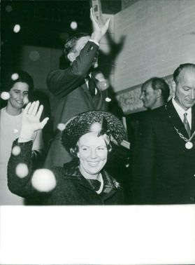 Beatrix and Claus of the Netherlands waving and smiling.