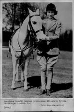 13-year-old Princess Elizabeth along with the family's horse.