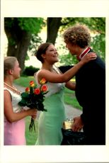 Crown Princess Victoria hugs one of the guests at her and friend Caroline Severin's graduation party at Ulriksdal Castle.