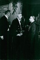 Charles de Gaulle talking to the man.