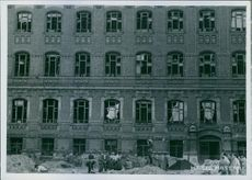 People standing in front of the building in Hungary during World War II.