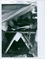 Treatment being given to soldier in tent in Vietnam.