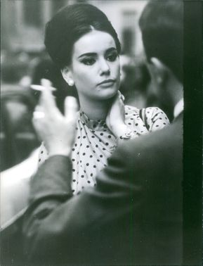Claudine Auger talking to a man.