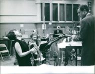 Musical Band in rehearsal with its music conductor, 1963.