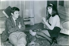 Danielle Gaubert sitting with her husband Olympic ski champion Jean-Claude Killy, while she looking at somewhere